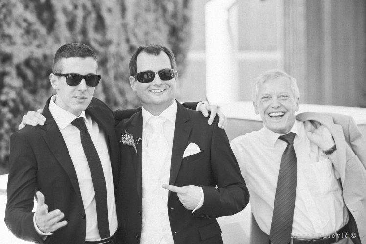 black and white wedding photography funny moment bestmen groom