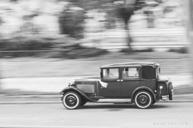 black and white wedding photography panning vintage car