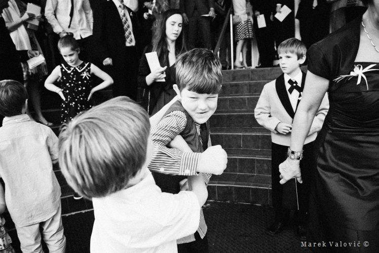 black & white wedding photography fighting boys