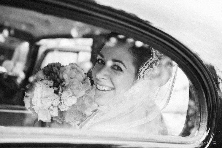 black and white wedding photography bride in old car
