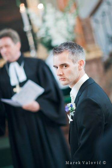 groom waiting in church ceremony