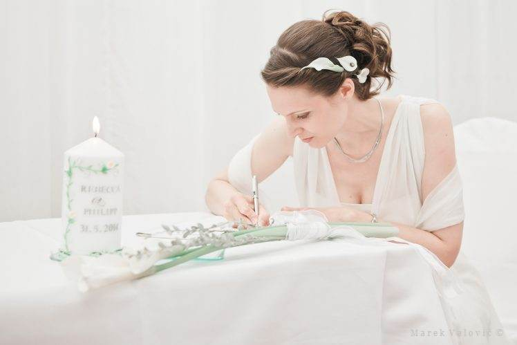 bride signing wedding contract
