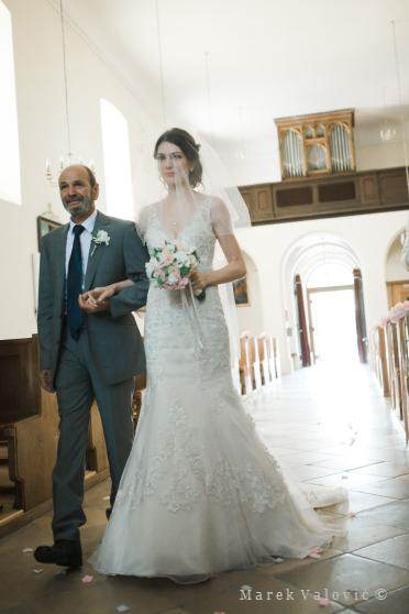 bride with father entering church - inside church