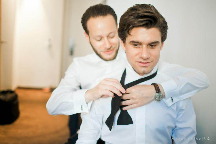 groom getting ready - butterfly tie