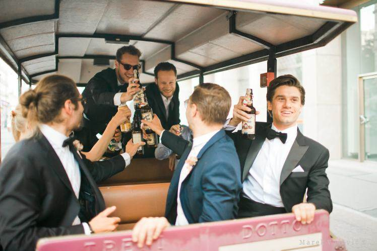 groom and bestman in the small city train drinking beer