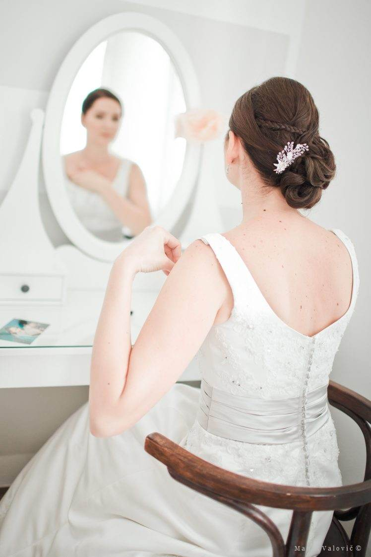 bride getting ready - mirror check - vintage styled wedding in Slovakia