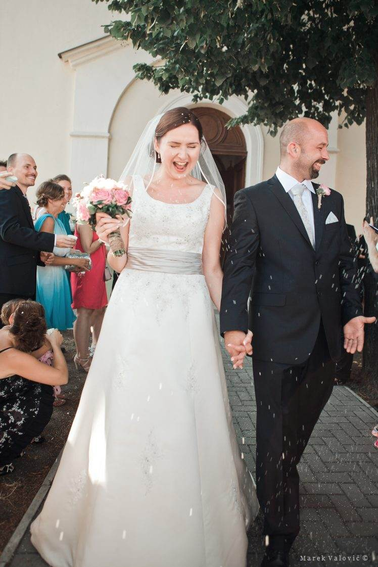 wedding emotions - rise falling on couple after ceremony