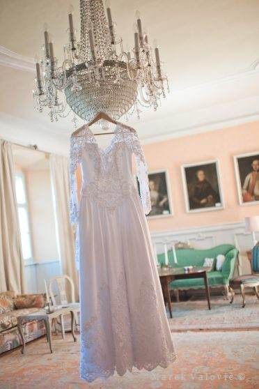 wedding dress in vintage castle room