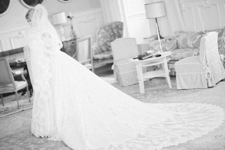 bride ready in her long wedding dress