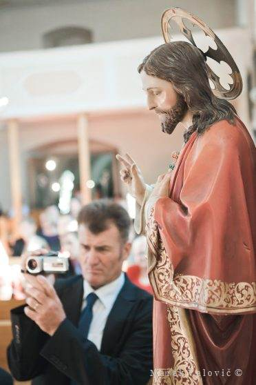 moment in the church ceremony - holy statue and man