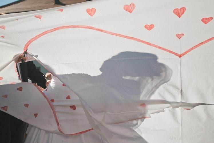 bride's shape on white sheet with heart
