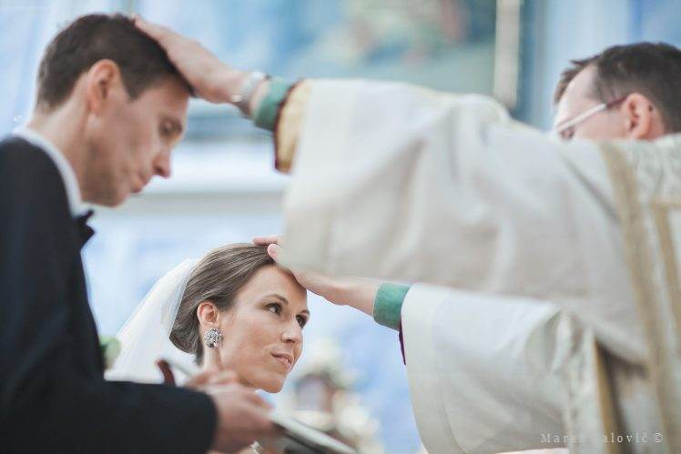 priest blessing bride and groom