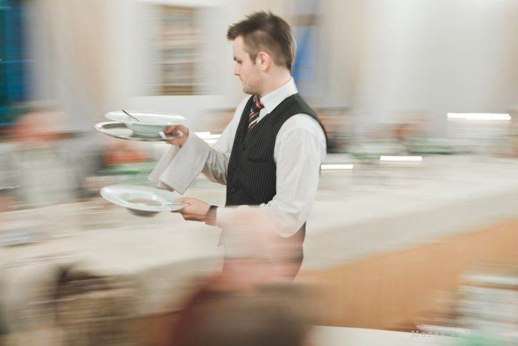 waiter moving fast - wedding photographer