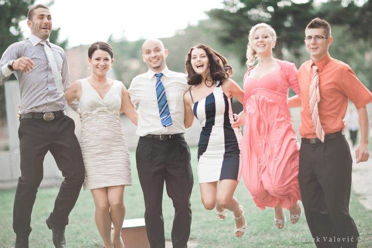 wedding group photo - jumping