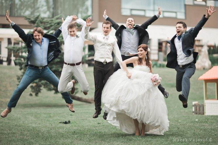 wedding group photo funny big jump