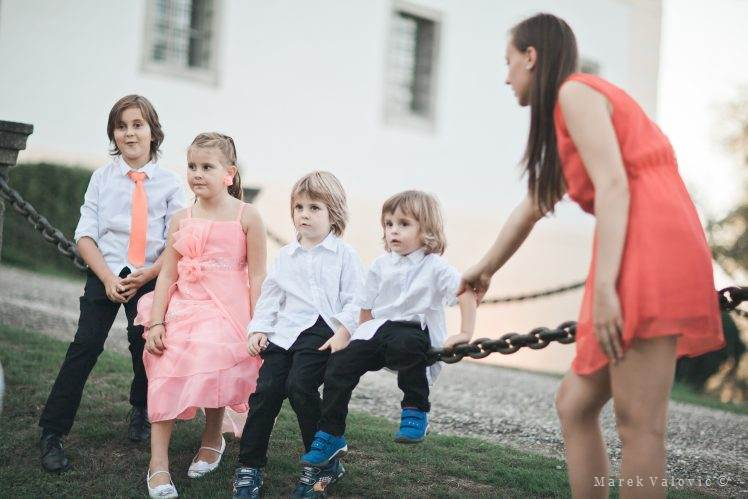 kids sitting on a chain