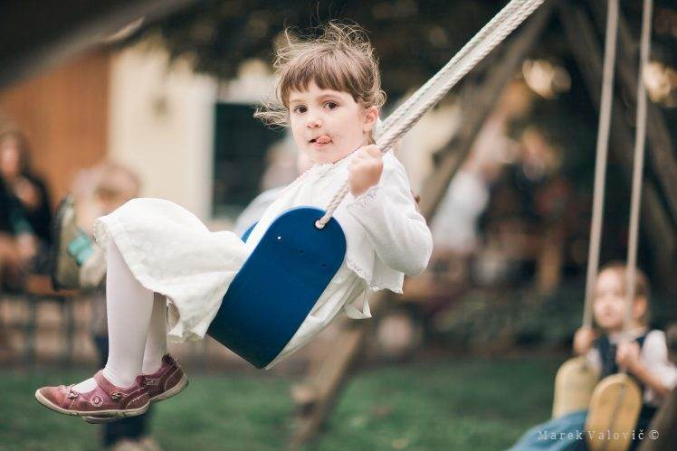 kid swinging on rocker - flip-flap