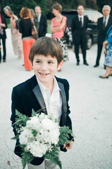 boy catching bouquet