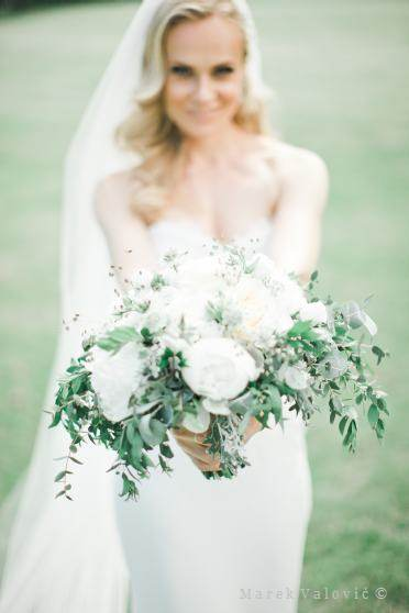fine art wedding photography posing bride with bouquet