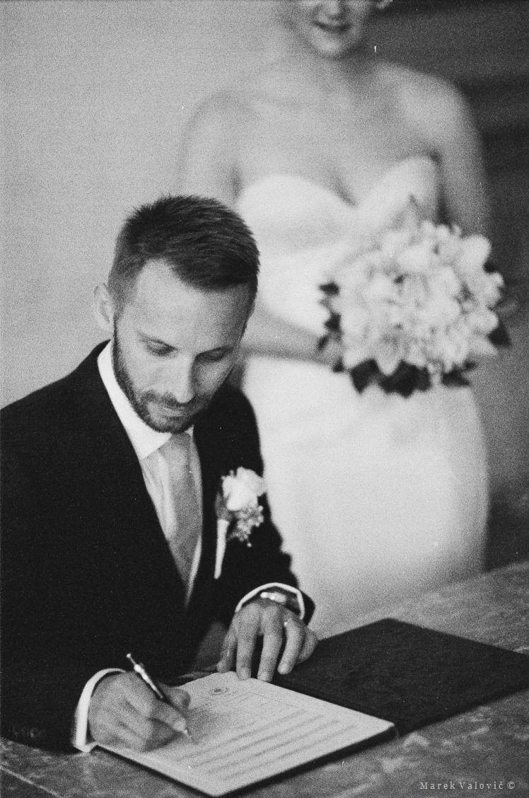 groom signing wedding papers - Ilford Delta 3200 - best wedding photo