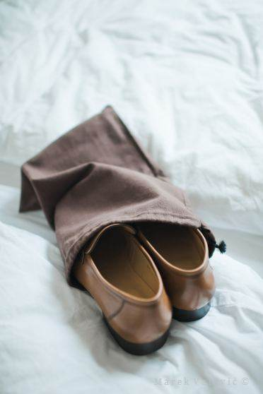 groom fetting ready - brown wedding shoes