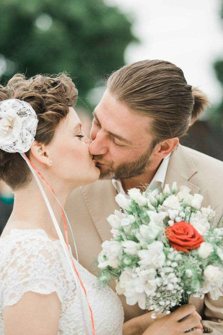 first kiss after wedding ceremony - vintage wedding - wedding photographer slovakia