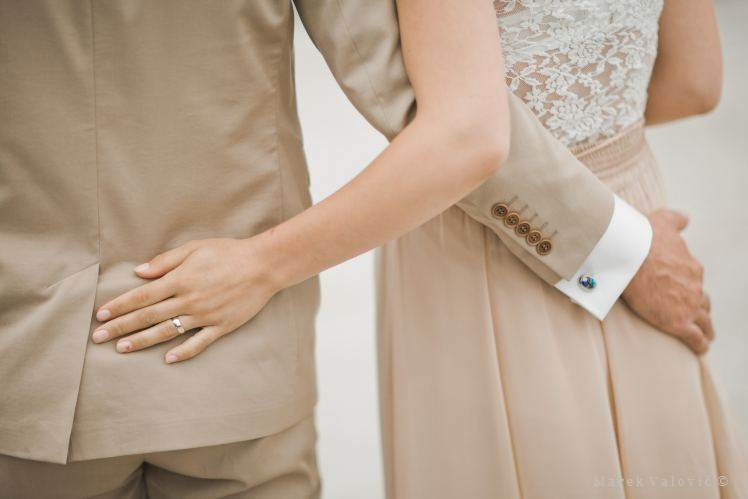 details - brode and groom in creamy dresses