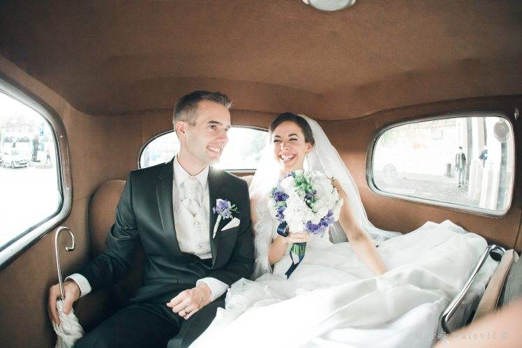bride and groom in vintage car newlyweds