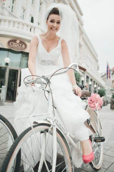 bride on bicycle red shoes