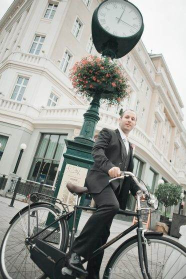 groom on wedding bicycle near Carlton Bratislava