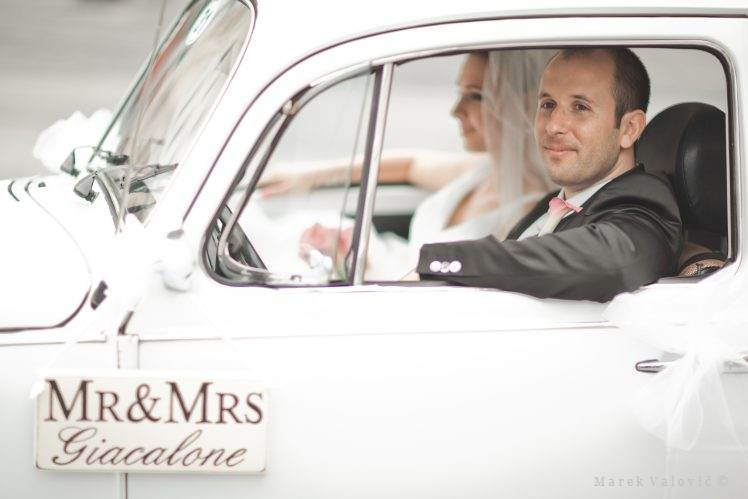 bride and groom in wedding car white VW beetle