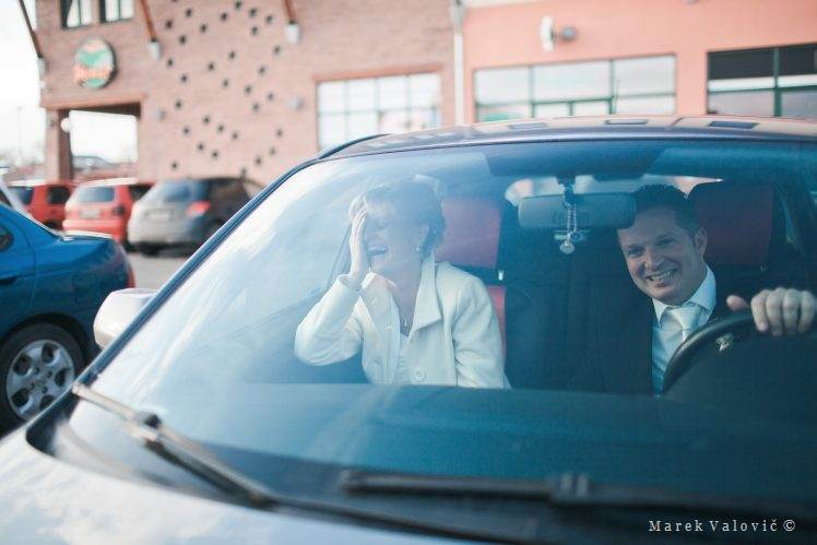 happy bride and groom in car