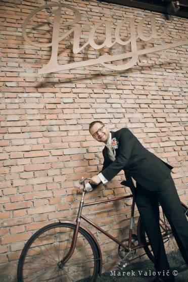 groom and vintage bicycle