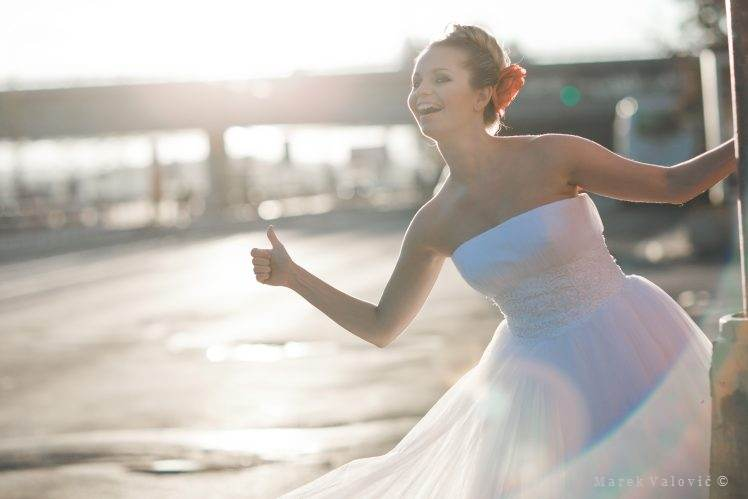 bride hitch hiking sun set