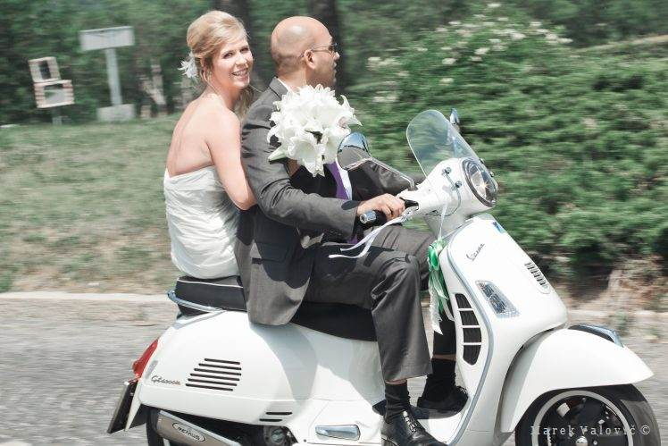 bride going to ceremony on Vespa bike