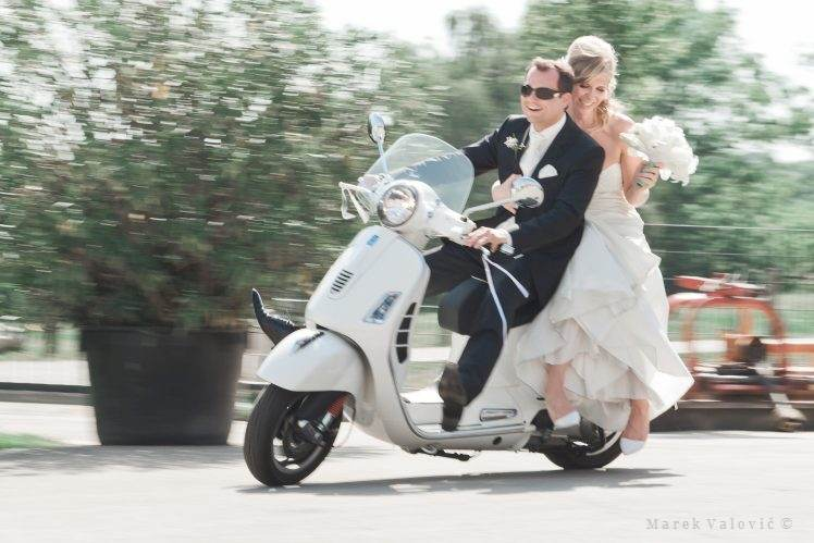 bride and groom on Vespa - panning photo